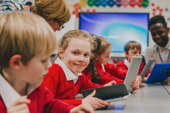 Children using laptops
